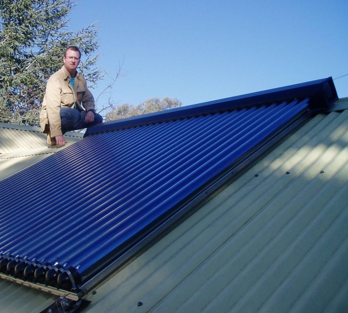 Mike on the roof with his solar hot water system